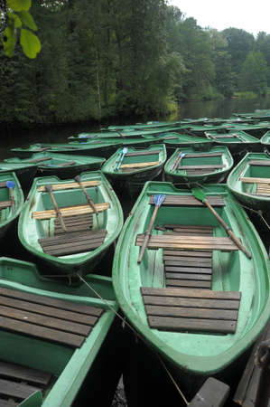 green boat: a lot of green boat at the pier