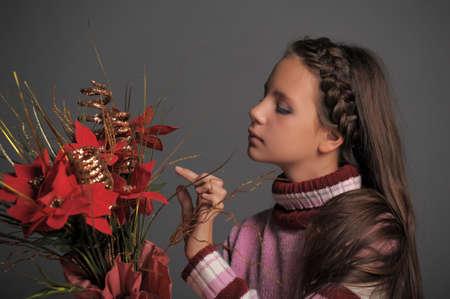 velvet dress: girl with Christmas flowers Stock Photo