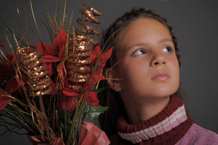girl with Christmas flowers photo