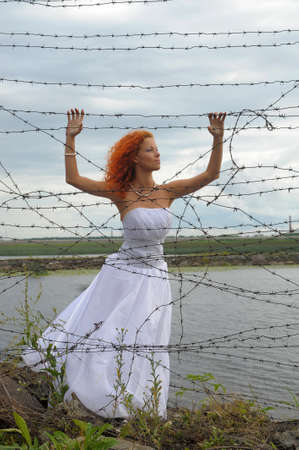 Bride with barbed wire photo