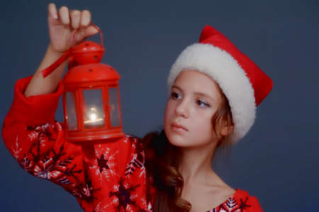 Girl with a Christmas lantern photo