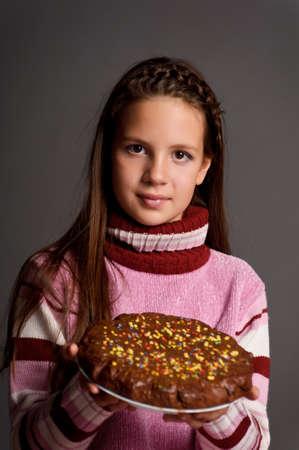 teen girl with cake in hand photo