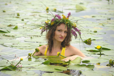 mermaid in the water with a wreath on head Stock Photo - 10778497