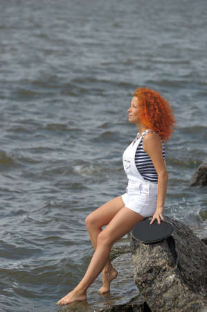girl sitting on a rock Stock Photo - 13344758