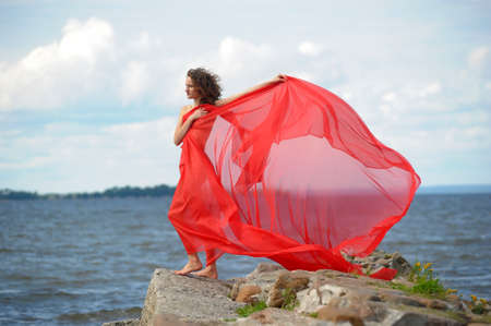 Beautiful hippie girl with red fabric photo