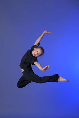Gymnast girl jumping studio Stock Photo - 11573923