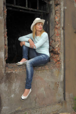woman sitting on the ruins Stock Photo - 10788987