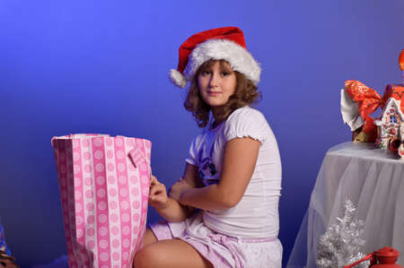 Girl and christmas gifts  photo