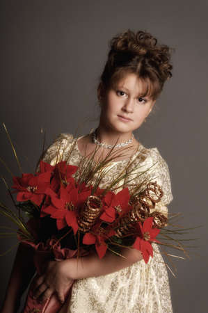 girl with a bouquet of Christmas flowers photo
