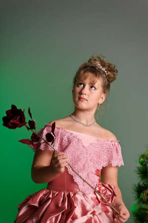 girl in a smart pink dress with a rose photo