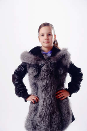 The girl the teenager in a fur jacket