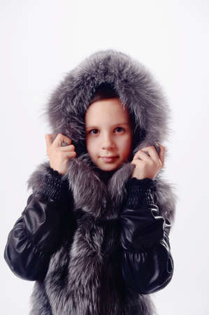 sheepskin: The girl the teenager in a fur jacket with a hood Stock Photo
