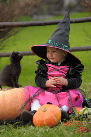 besom: little witch with a black kitten