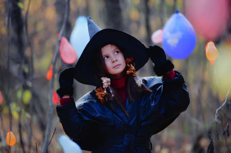 Small girl in a witch halloween costume photo