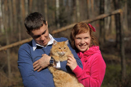 Young couple spends time playing with their pet cat  photo