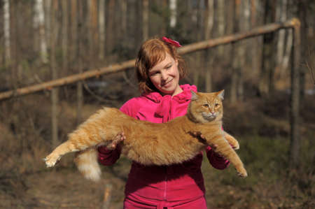 The girl with a red cat photo