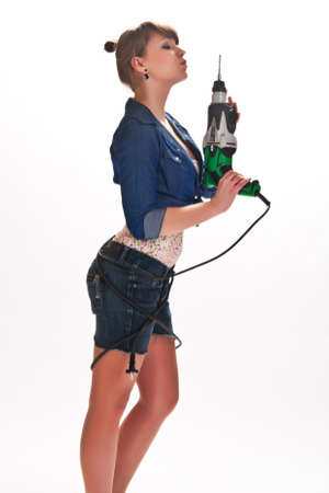 girl with a drill in the hands Stock Photo