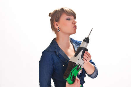 gladden: girl with a drill in the hands Stock Photo