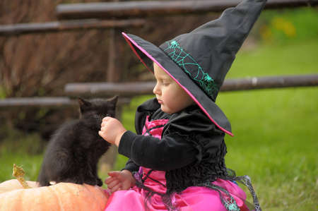 suburbia: little witch with a black kitten
