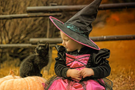 nov: little witch with a black kitten