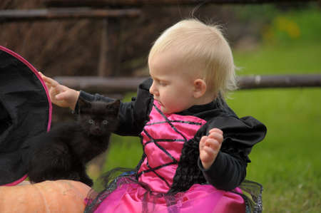 little witch with a black kitten photo