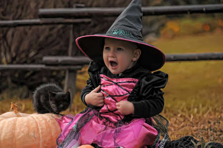 little witch with a black kitten Stock Photo - 10908857