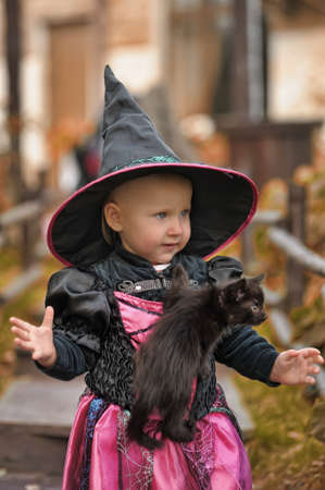little witch with a black kitten
