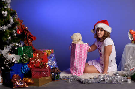 girl at Christmas with gifts