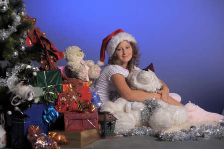 girl at Christmas with gifts Stock Photo - 10921590