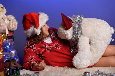 girl at Christmas with gifts photo