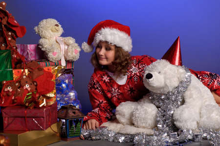 girl at Christmas with gifts Stock Photo - 10921620