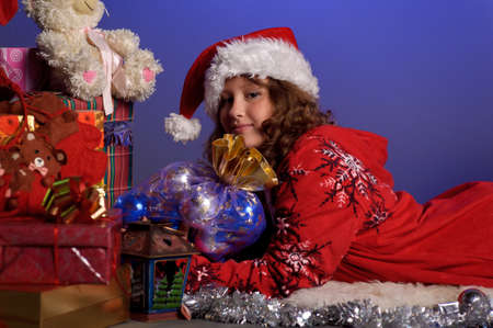 girl at Christmas with gifts Stock Photo - 10921601