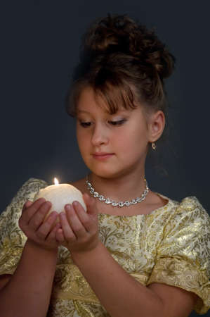 Young beautiful, girl portrait by glow of candlelight Stock Photo - 10921613