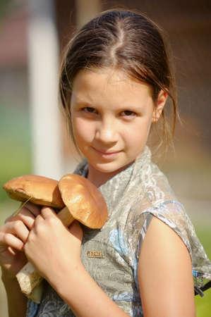 boastful: girl displays mushrooms
