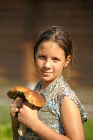 girl displays mushrooms