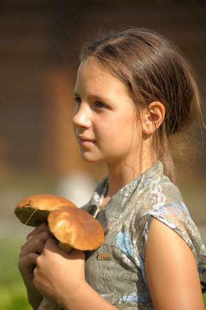 girl displays mushrooms photo