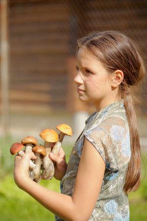 girl displays mushrooms Stock Photo - 13306382