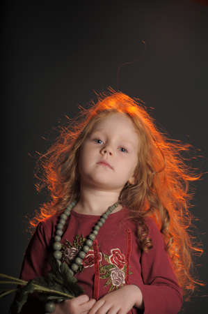 portrait of the little red-haired girl photo