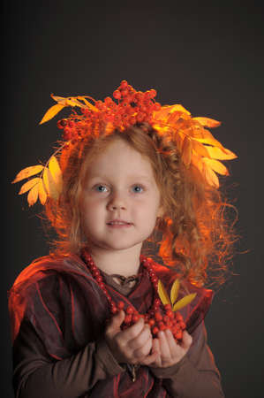 Autumn portrait of the little red-haired girl photo