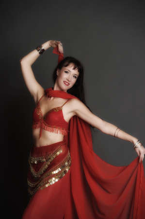 The woman dancing in red east suit  photo