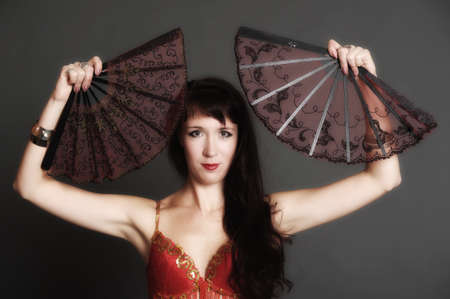 The woman with two fans Stock Photo - 11039101