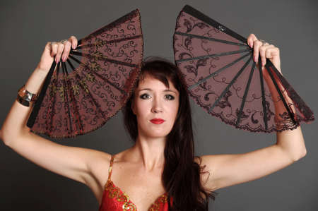 The woman with two fans Stock Photo - 11039106