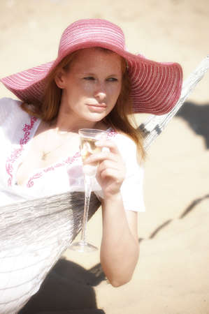 woman looking down: The young woman in a hammock Stock Photo