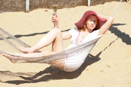 woman lying down: The young woman in a hammock Stock Photo