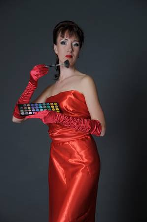 The woman in red with a cosmetics palette  photo