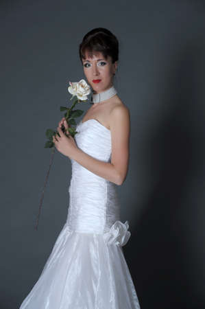 The happy bride with a white rose  photo