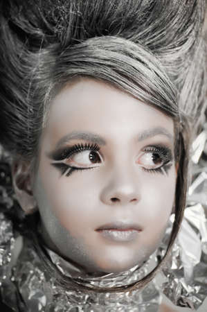 girl in silver and foil  Stock Photo - 11019954