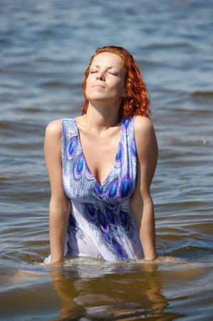 young woman in a dress in the water