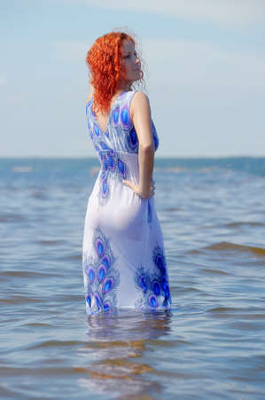 young woman in a dress in the water Stock Photo - 12025528