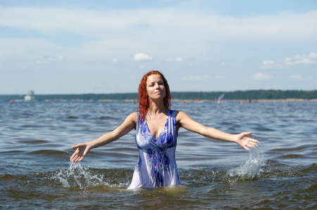 Young woman playing with water. Stock Photo - 12025614